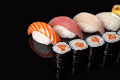 Sushi rolls and sashimi Stock Photo
