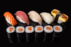 Sushi rolls and sashimi Royalty Free Stock Images