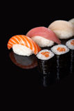 Sushi rolls and sashimi Royalty Free Stock Image