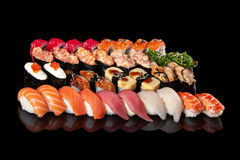 Sushi rolls and sashimi Stock Photos