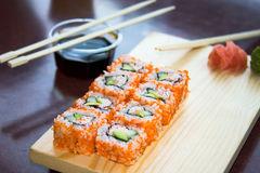 Sushi rolls with sauce. California sushi rolls with sauce on plate stock photo