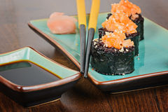 Sushi rolls served on blue plate Royalty Free Stock Images