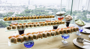 Sushi rolls served on glass plate Stock Photography