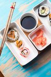 Sushi rolls served in special dishes Royalty Free Stock Image