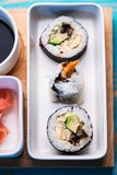 Sushi rolls served in special dishes Royalty Free Stock Photos