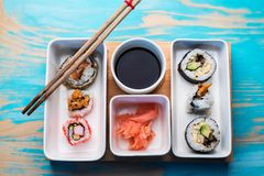Sushi rolls served in special dishes Royalty Free Stock Photo