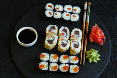 Sushi rolls served on stone slate red caviar Stock Image