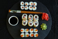 Sushi rolls served on stone slate red caviar Royalty Free Stock Image