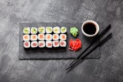 Sushi rolls served on stone slate Royalty Free Stock Photo