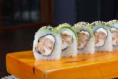 Sushi rolls served in wood - Image royalty free stock photos