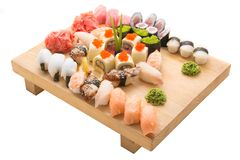 Sushi rolls served on a wooden plate in a restaurant Royalty Free Stock Photo