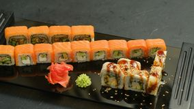 Sushi rolls set assortment asian cuisine food. Asian cuisine and japanese food. sushi rolls set assortment on dark background stock video