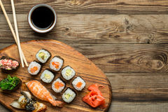 Sushi and rolls set with crossed sticks stock image