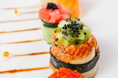 Sushi rolls set, fusion food style restaurant menu. Sushi rolls degustation, fusion food style restaurant menu, deluxe gastronomy. Set of finest seafood snacks royalty free stock photos