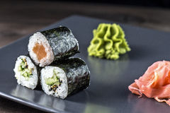 Sushi rolls set. Kappamaki and Sakemaki with pickled ginger and wasabi sauce Royalty Free Stock Image