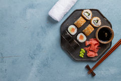 Sushi rolls set with marinated ginger, soy sauce and wasabi Stock Images