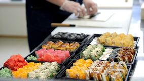 Sushi and rolls set in a plastic box. Delivery service consept