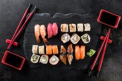 Sushi rolls set. Served on black stone slate Royalty Free Stock Photo