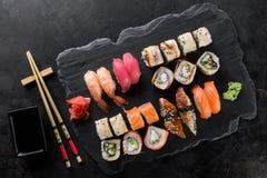 Sushi rolls set. Served on black stone slate Stock Images