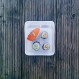 Sushi rolls set on stone slate Stock Photo