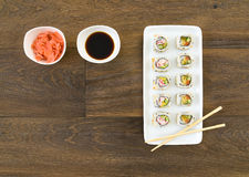 Sushi rolls set, top view, wooden background Royalty Free Stock Photos