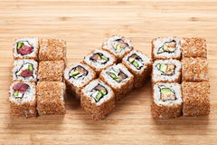 Sushi rolls set with tuna and smoked eel  on the wooden background Stock Images