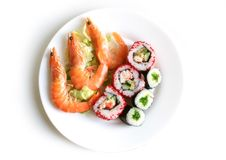 Sushi rolls with shrimps. On the white plate Royalty Free Stock Photos