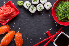 Sushi and rolls on a slate table Stock Images