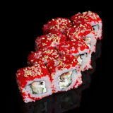 Sushi rolls with soft cheese, eel, cucumber and flying fish roe Royalty Free Stock Image