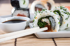 Sushi rolls with sticks and Soy Sauce Stock Photos