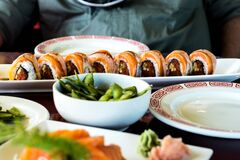 Sushi rolls on table Stock Photography