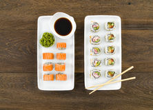 Sushi rolls, top view, wooden background Stock Image
