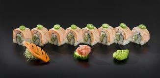 Sushi rolls. Uramaki maki sushi with sliced green pepper Royalty Free Stock Images