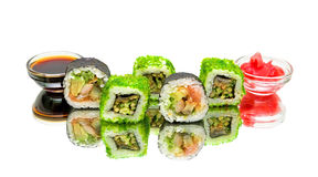 Sushi and rolls on a white background with a mirror reflection Stock Photos