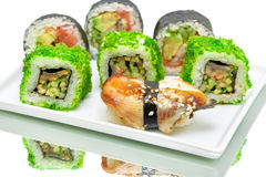 Sushi and rolls on a white background Stock Photography