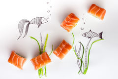 Sushi. Rolls, on white with drawings of fish and seaweed stock image