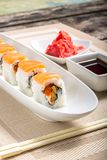 Sushi rolls in White Long Dish with soy sauce Stock Image