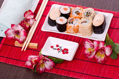 Sushi rolls on the white plate Stock Photography