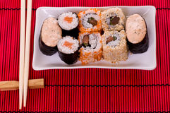 Sushi rolls on the white plate Royalty Free Stock Image