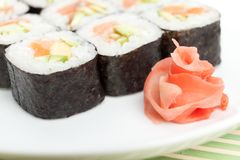 Sushi rolls on the white plate Royalty Free Stock Photo