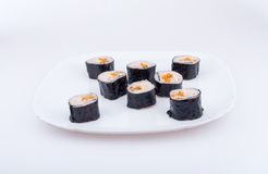 Sushi rolls. On a white plate Royalty Free Stock Photos