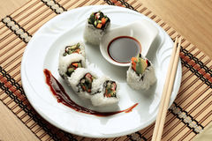 Sushi rolls in a white plate Royalty Free Stock Images