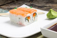 Sushi rolls in white plate with chopsticks and japanese spices Stock Image