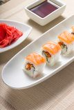 Sushi rolls in white plate with chopsticks and japanese spices Stock Photos
