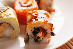 Sushi rolls on a white plate closeup Stock Photography