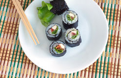 Sushi rolls on white plate closeup Royalty Free Stock Photography