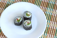 Sushi rolls on white plate closeup Stock Photos