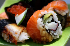 Sushi rolls wirth salmon. Sushi rolls with salmon,red caviar and eel close up Royalty Free Stock Image
