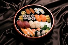 Sushi rolls on a wood plate. Royalty Free Stock Image