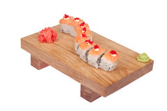 Sushi rolls on wood stand Royalty Free Stock Images